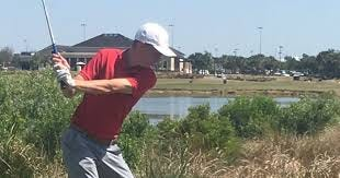 Defending champion Kyle Decenzo of Florida Tech hits his tee shot on the 18th hole of Duran Golf Club.