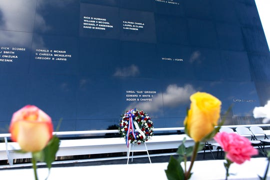 Flowers were placed in front of the Space Mirror Memorial at the Kennedy Space Center Visitor Complex after NASA's annual Day of Remembrance ceremony on Feb. 7, 2019. The memorial, a 42-foot-high by 50-foot-wide granite monument, displays the names of the fallen astronauts from Apollo 1, space shuttles Challenger and Columbia, as well as others who have lost their lives while on NASA missions or in training. Each year, Kennedy employees and guests gather with others throughout NASA to honor those astronauts who have fallen in the pursuit of space exploration.