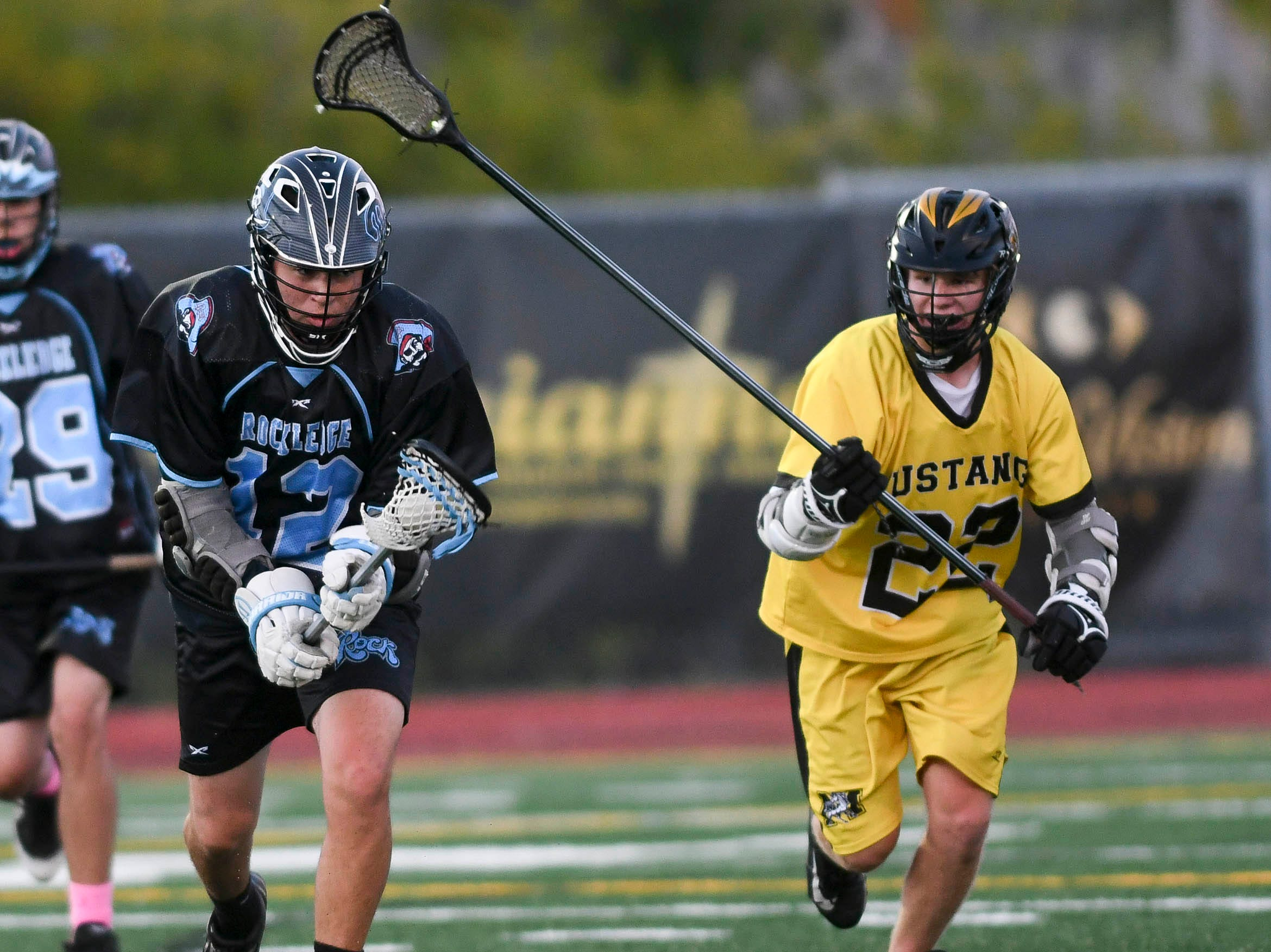 Kyle Ruether of Rockledge is chased by Jacob Loufer of Merritt Island during Wednesday's game.