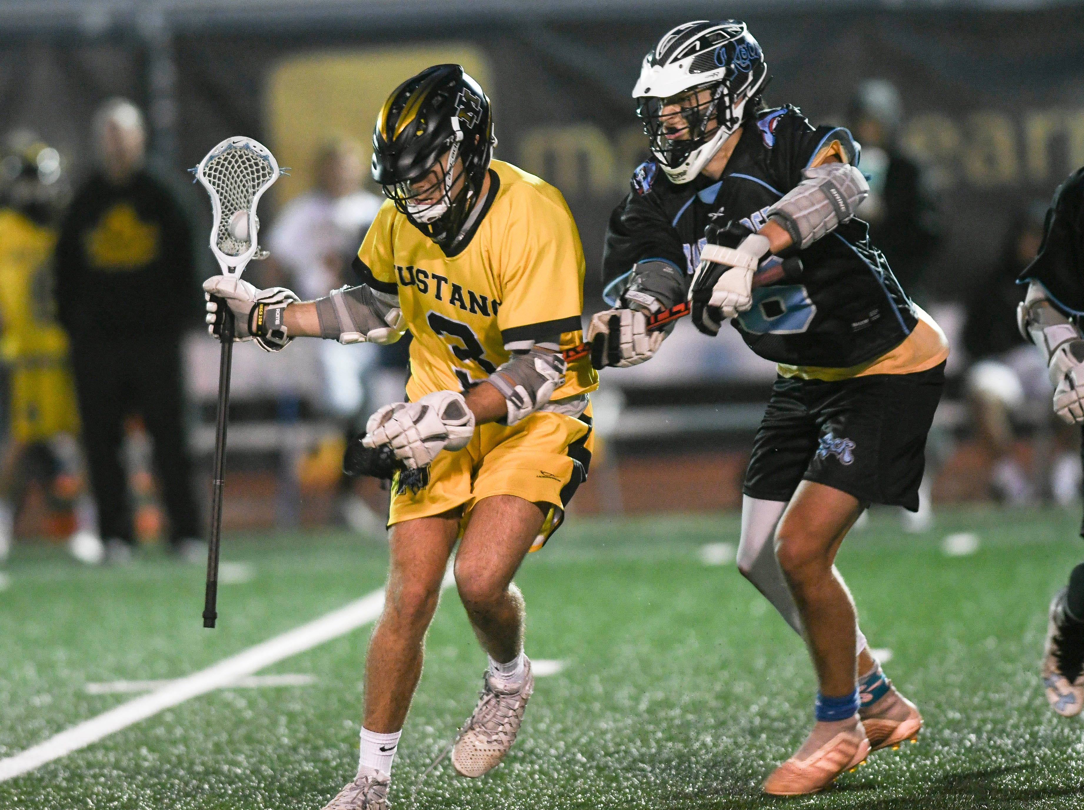 Nick Sidor of Merritt Island is harassed by Hayden Knight of Rockledge during Wednesday's game.