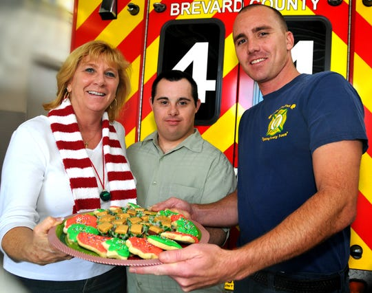 Betsy Farmer's favorite thing is baking cookies with her son, Luke. In this 2012 photo, they took cookies to her other son, Josh, who works at Brevard County Station 44.