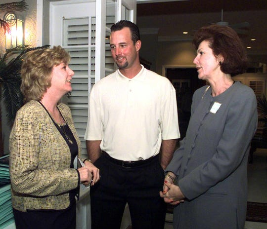 In 1998, Tim Wakefield (center) spoke with Betsy Farmer of the Space Coast Early Intervention Center and Judy McCarthy of Legg Mason (right) during a sponsor dinner at his Suntree home.