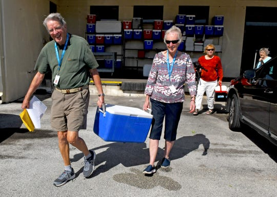 Volunteer drivers Bob and Bonnie McClellan of Viera pick up meals at the Brevard Community Kitchen in Cocoa, food which they'll deliver for the Meals on Wheel program.
