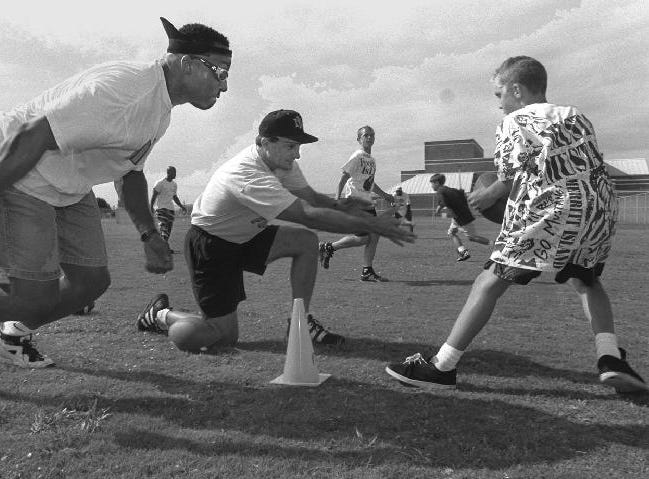 Derek Brown (left), the 14th overall pick in the 1992 NFL Draft, taken by the New York Giants, participates in a football camp at alma mater Merritt Island in 1996.