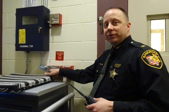 Crawford County Sheriff Scott Kent points out a fire alarm panel that will need to be replaced soon.