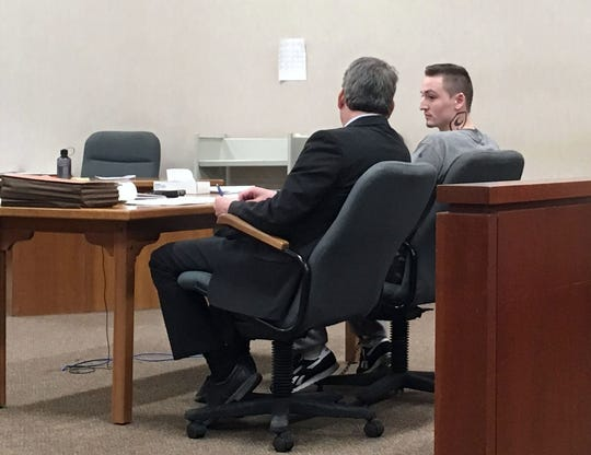 Jordan Paul, 24, right, appears in Vermont Superior Court in Burlington with his lawyer Bob Katims on March 28, 2019, for sentencing.