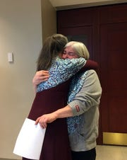 Barbara Beede, mother to Amos Beede, embraces Victim's Advocate Nietra Panagoulis following the sentencing hearing on March 28, 2019, for the fifth person convicted in the beating death of her son.