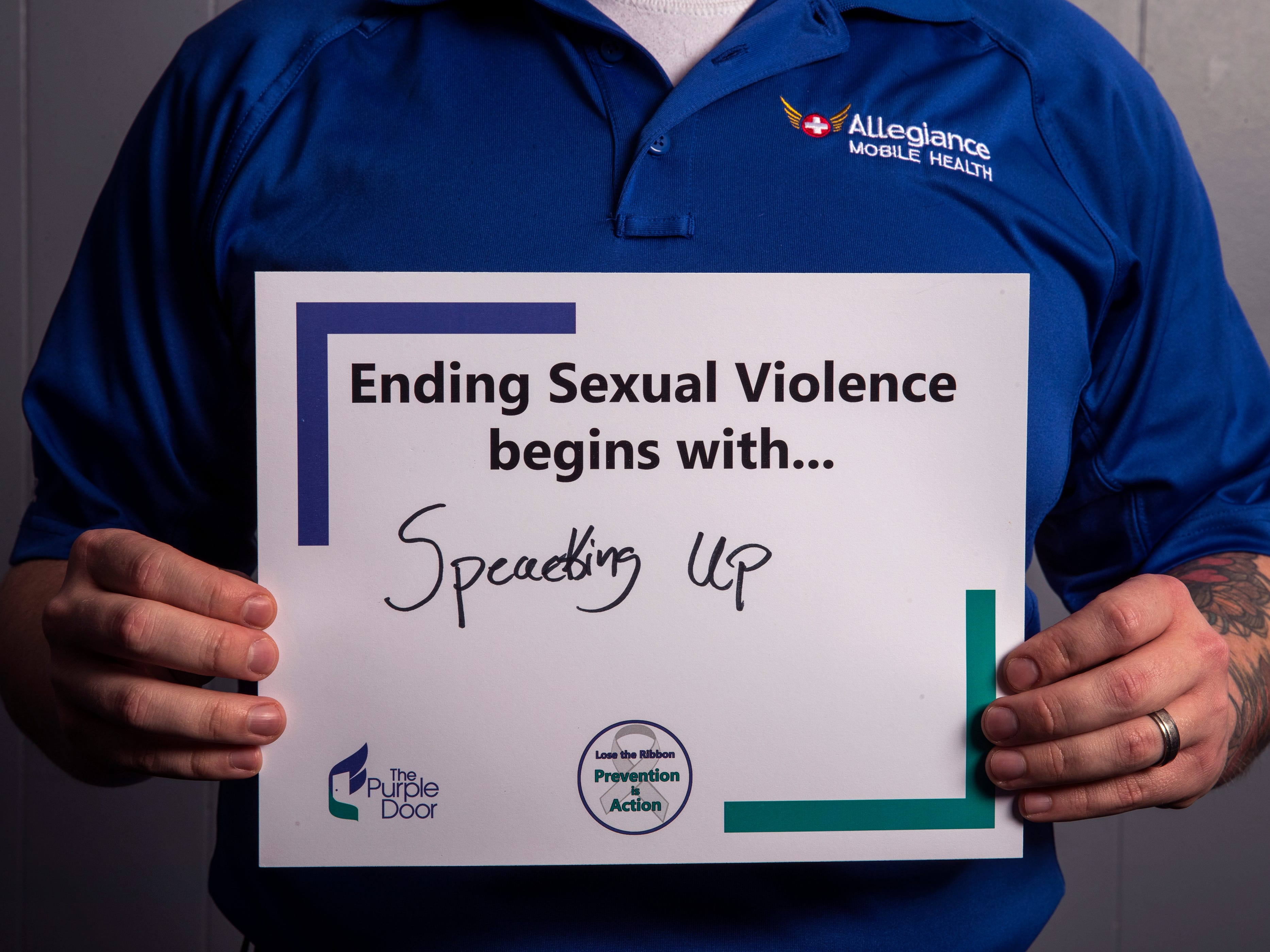 Harold Brown, an EMT with Allegiance Mobile Health, has pledged to help his patients have a voice. He is one of several people to participate in The Purple Door's campaign for April's Sexual Assault Awareness Month, which encourages people to take action against sexual assault and violence.