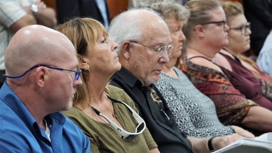 Port Aransas residents listen to discussion on the Port of Corpus Christi's Harbor Island marine terminal project at a March 28, 2019 meeting.
