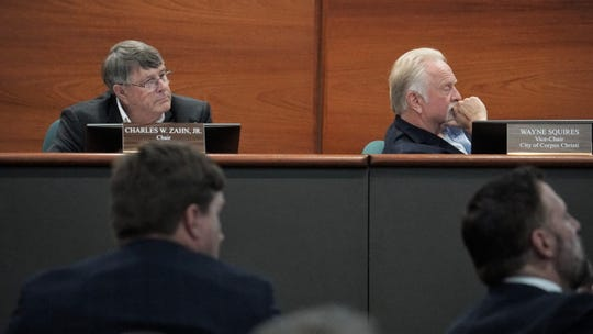 Port of Corpus Christi Chair Charlie Zahn, left, and port commissioner Wayne Squires listen to Port Aransas residents voice their concerns about its Harbor Island marine terminal project during a March 28, 2019 meeting.