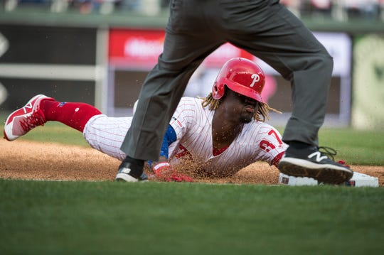 Phillies' Odubel Herrera (37) slides safe into third during an opening day game against the Braves Thursday, March 28, 2019 in Philadelphia. Phillies won 10-4.