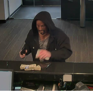Police search for man wanted in TD Bank robbery