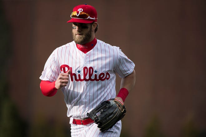 Phillies' Bryce Harper (3) comes off the field during an opening day game against the Braves Thursday, March 28, 2019 in Philadelphia. Phillies won 10-4.