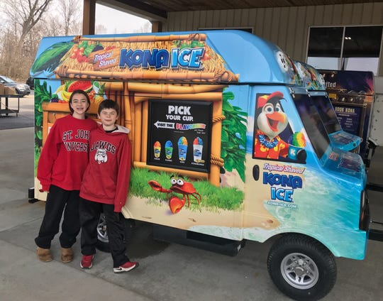 Delaney (left), 13 and Edward, 11, accompanied their dad Ed Purdy to Kona Ice headquarters in Kentucky to select a kiosk for the Cherry Hill Mall. It's the third Kona Ice unit the Haddonfield family has purchased since launching their franchise in the fall.