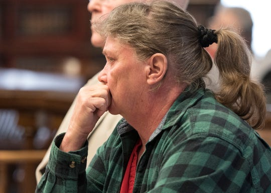 Rita Newcomb, shown here during a previous court appearance, pleaded guilty Monday to obstructing official business in exchange for dropping forgery charges in connection with documents tied to a murder investigation.