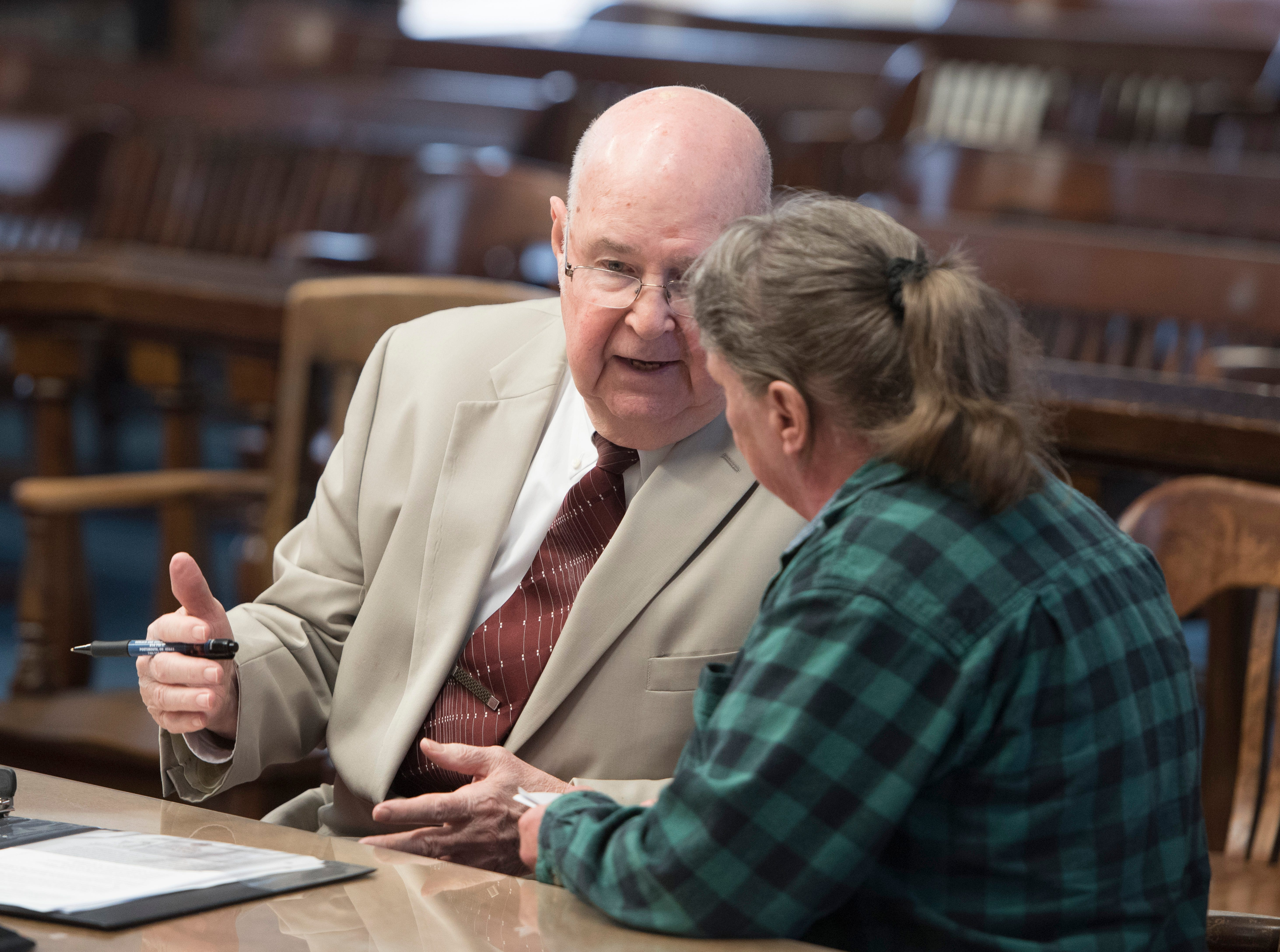 Rita Newcomb confers with her lawyer Franklin T. Gerlach shortly before Judge Randy Deering enters the courtroom at the Pike County Courthouse on March 28, 2019. Newcomb, 65, of South Webster, is accused of perjury and obstructing justice for allegedly misleading investigators concerning the deaths of the eight members of the Rhoden family in 2016 and is also charged with forging custody documents to cover up the crimes.