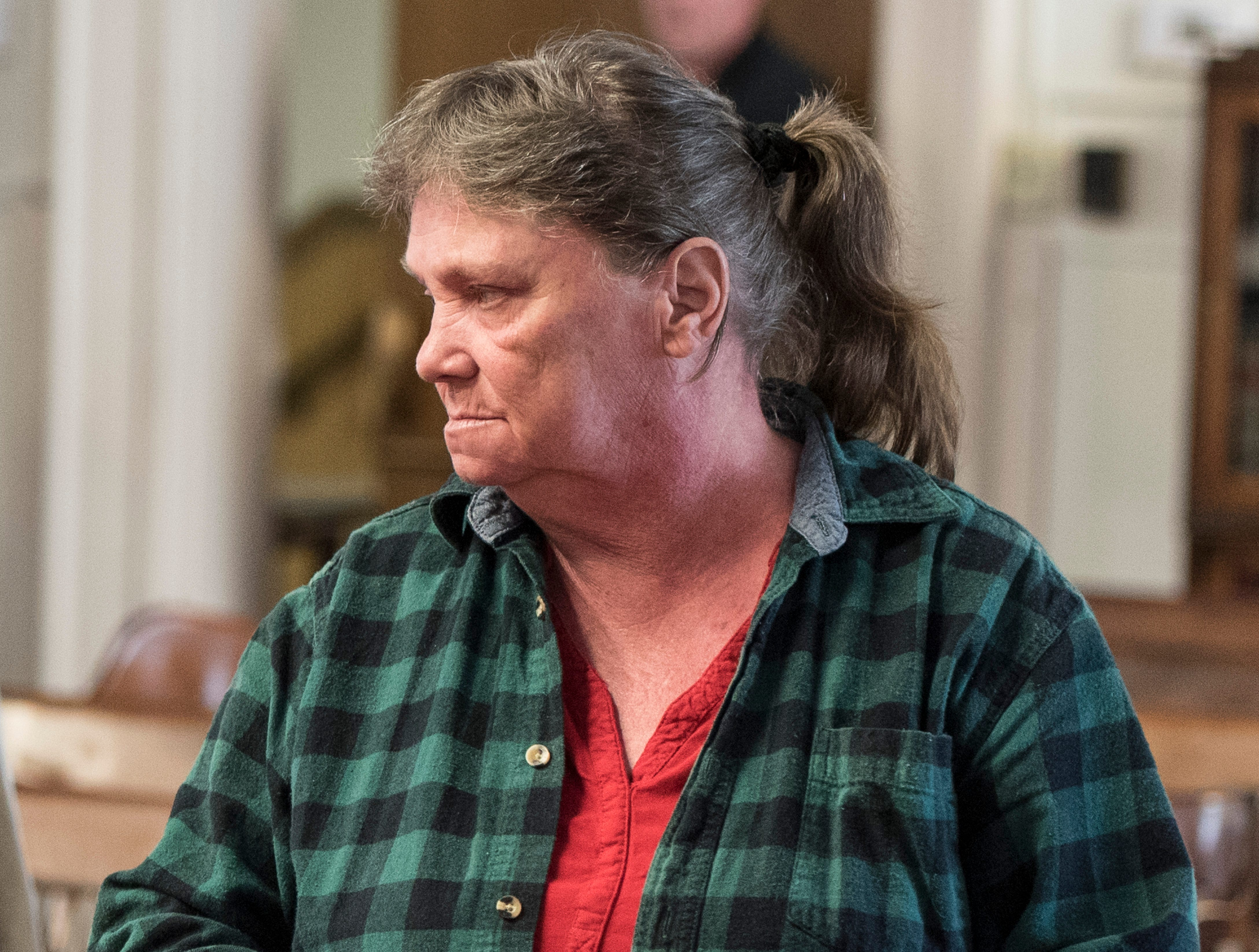 Rita Newcomb enters the courtroom to learn about her trial dates at the Pike County Courthouse on March 28, 2019. Newcomb, 65, of South Webster, is accused of perjury and obstructing justice for allegedly misleading investigators concerning the deaths of the eight members of the Rhoden family in 2016 and is also charged with forging custody documents to cover up the crimes.