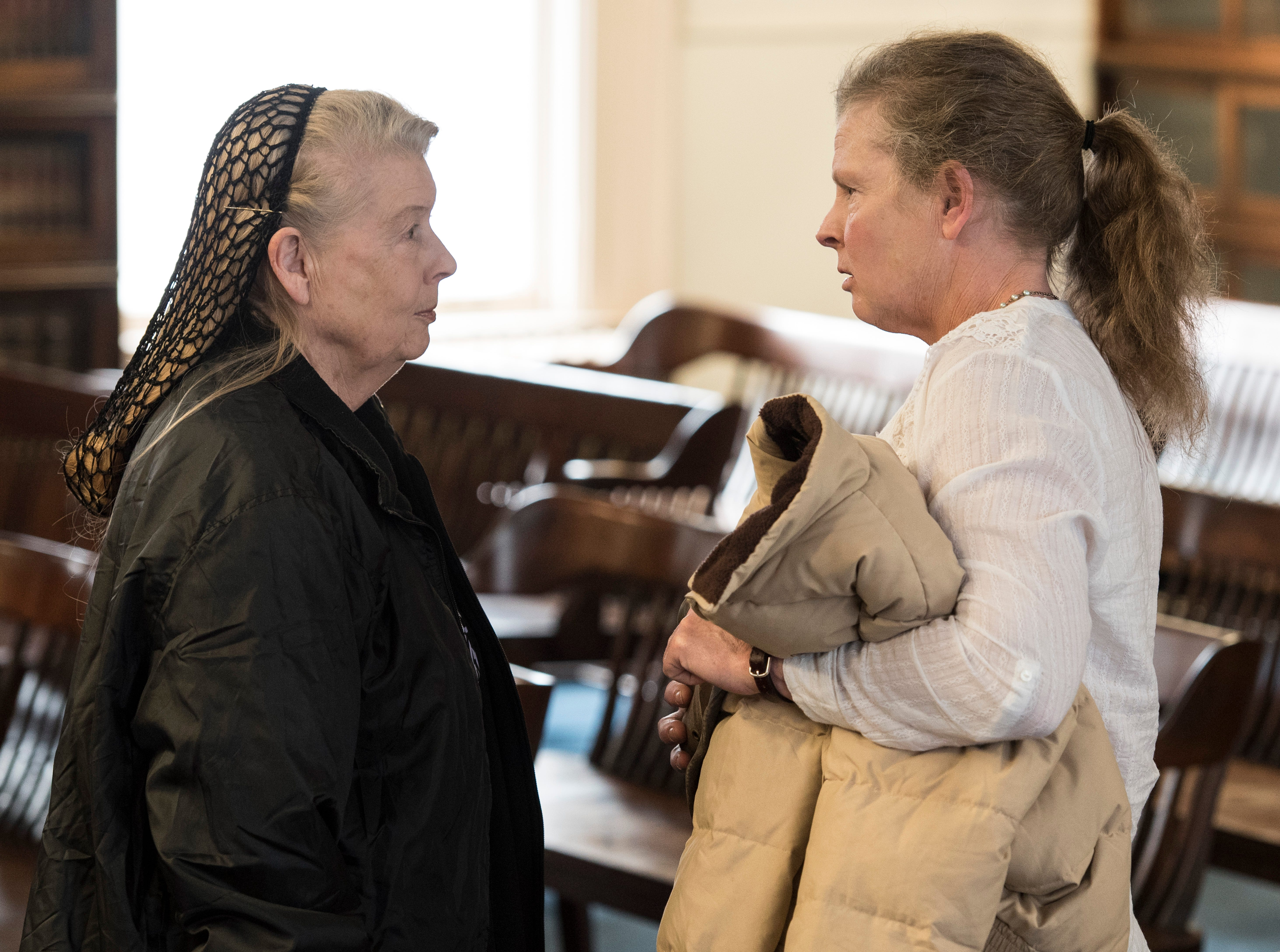 Fredericka Wagner, left, briefly talks with Robin Wagner after her pretrial hearing with Judge Randy Deering on March 28, 2019. Wagner is accused of perjury and obstructing justice for allegedly misleading investigators in the 2016 investigation concerning the murder of eight members of the Rhoden family.