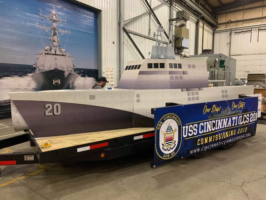 A mock up of the USS Cincinnati, this float was built for the Cincinnati Reds Opening Day parade.