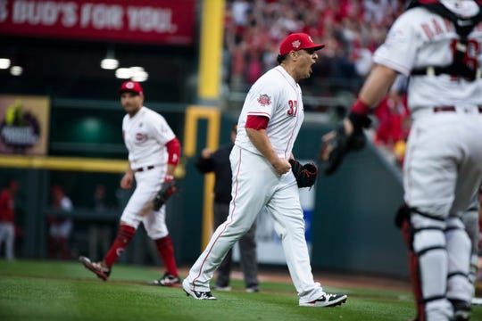 Cincinnati Reds relief pitcher David Hernandez (37) celebrates after the Opening Day MLB baseball game between Cincinnati Reds and Pittsburgh Pirates on Thursday, March 28, 2019, at Great American Ball Park in Cincinnati. Cincinnati Reds defeated Pittsburgh Pirates 5-3.