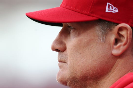 Cincinnati Reds manager David Bell (25) observes the game in the sixth inning of an MLB baseball game, Thursday, March 28, 2019, at Great American Ball Park in Cincinnati.