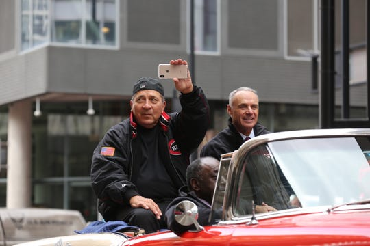 Reds legend Johnny Bench rides along in the Findlay Market Opening Day Parade with the grand marshal, Commissioner of Baseball Rob Manfred.