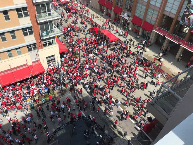 Reds fans flood the streets of the Banks for the block party.