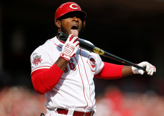 Cincinnati Reds right fielder Yasiel Puig (66) licks his bat after fouling off a pitch in the third inning of the Opening Day game between the Cincinnati Reds and the Pittsburgh Pirates at Great American Ball Park in downtown Cincinnati on Thursday, March 28, 2019.