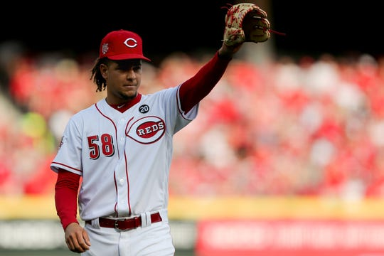 Cincinnati Reds starting pitcher Luis Castillo (58) recognizes the crowd after being pulled out of the game in the sixth inning of an MLB baseball game against the Pittsburgh Pirates, Thursday, March 28, 2019, at Great American Ball Park in Cincinnati.