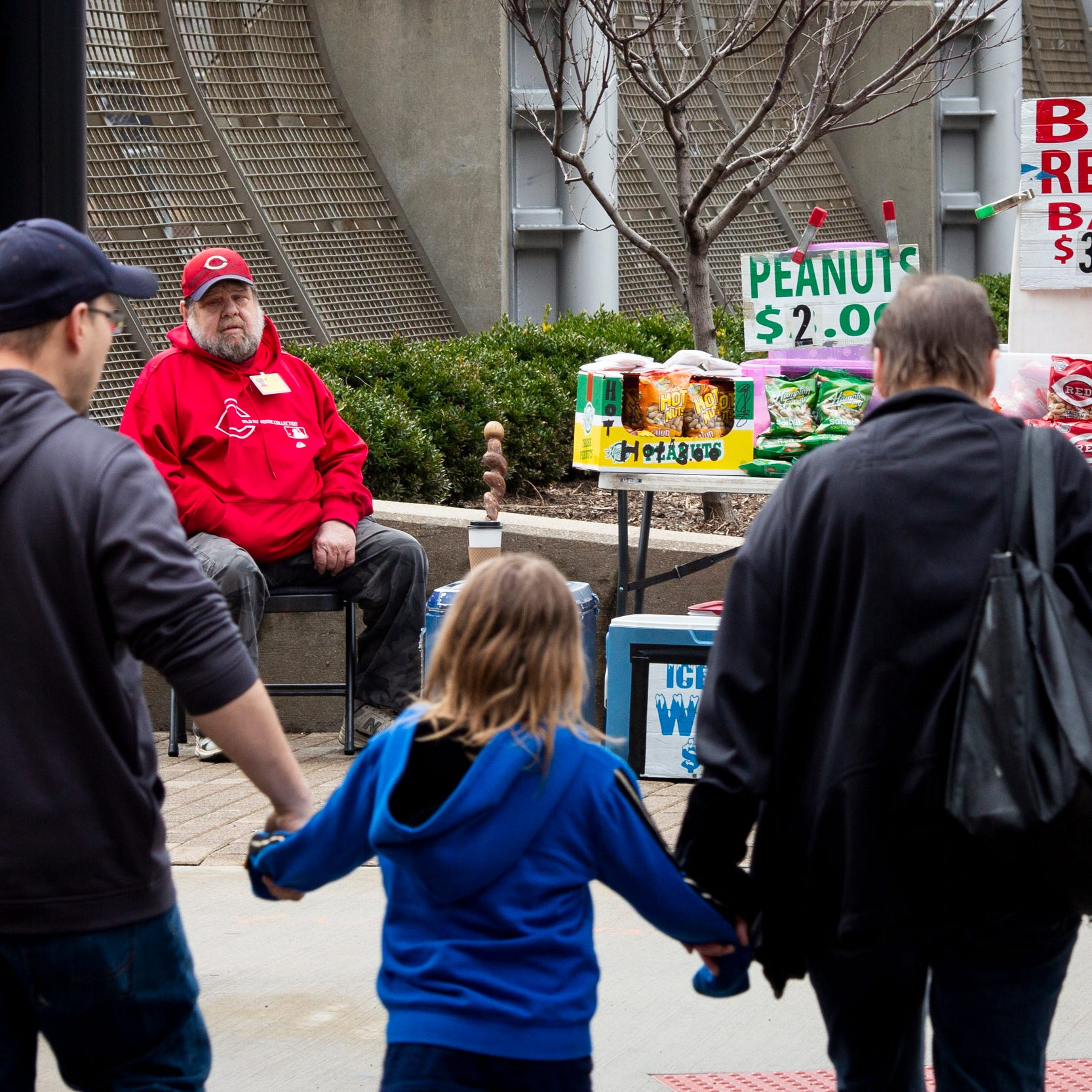 Larry Mullins sits on the corner of Third Street and Walnut Street in downtown Cincinnati before Cincinnati Reds Opening Day game against the Pittsburgh Pirates at Great American Ball Park Thursday, March 28, 2019. Mullins has been selling peanuts for the last 20Êyears at Reds and Bengals home games.