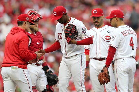Cincinnati Reds manager David Bell (25) takes out Cincinnati Reds relief pitcher Raisel Iglesias (26) in the ninth inning of an MLB baseball game against the Pittsburgh Pirates, Thursday, March 28, 2019, at Great American Ball Park in Cincinnati.