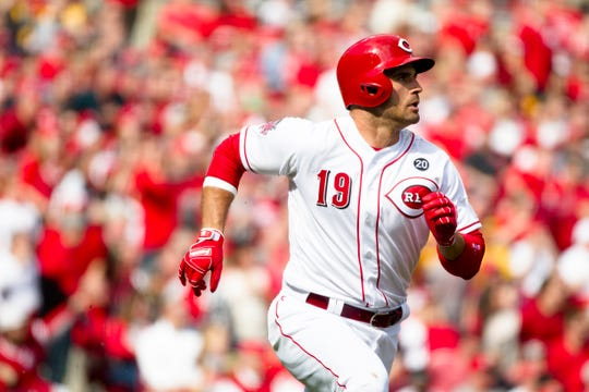 Cincinnati Reds first baseman Joey Votto (19) watches his ball fly after hitting a double in the first inning of the Opening Day MLB baseball game between Cincinnati Reds and Pittsburgh Pirates on Thursday, March 28, 2019, at Great American Ball Park  in Cincinnati.