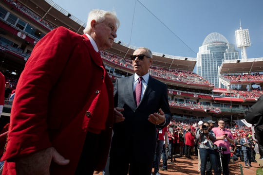 Rob Manfred, MLB commissioner, speaks to Cincinnati Reds CEO Bob Castellini before the Opening Day MLB baseball game between Cincinnati Reds and Pittsburgh Pirates on Thursday, March 28, 2019, at Great American Ball Park in Cincinnati.