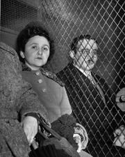 Ethel Rosenberg and her husband, Julius, are separated by a wire screen as they ride to jail in New York City March 29, 1951 following their conviction as traitors in the nation's first atom spy trial.
