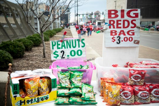Larry Mullins sells peanuts on Third Street and Walnut Street in downtown Cincinnati before Cincinnati Reds Opening Day game Thursday, March 28, 2019.