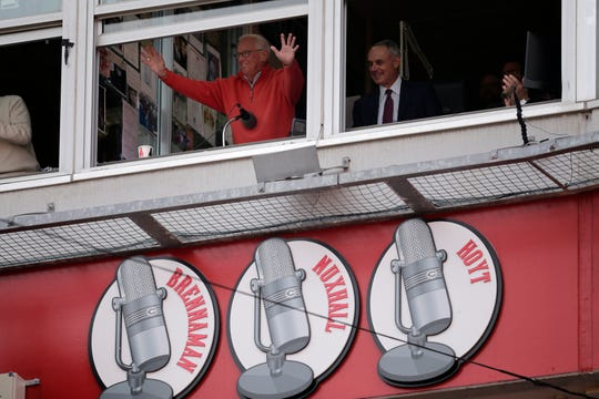 Hall of Fame broadcaster Marty Brennaman waves to fans as his farewell season is announced in the second inning of the Opening Day game between the Cincinnati Reds and the Pittsburgh Pirates at Great American Ball Park in downtown Cincinnati on Thursday, March 28, 2019.