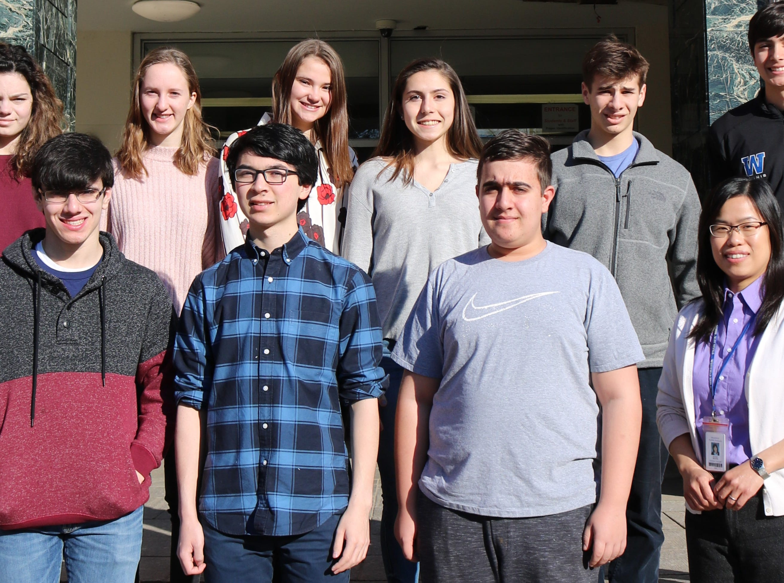 Nine Westfield High School juniors earned perfect scores on sections of the February 2019 ACT, bringing to 13 the number of WHS students scoring a perfect 36 on portions of the February ACT. Previously announced were Henry Meiselman (Science & STEM), Abbey Zidel (English), Brianna Weber (Reading), and Jacob Rock (English & Reading).    Pictured here are: (front row, left to right) Mark Falletta (Science & STEM), Stephen Park (Science), Alexander Joseph (Math, Science & STEM) and WHS assistant principal Mabel Huynh. (back row, left to right) Abigail Sternberg (Reading), Celeste Scott (Reading), Greta McLaughlin (Reading), Sandrine Perez (Science), Jonathan Sherman (Science & Reading), and Brad Hornbeck (Math).