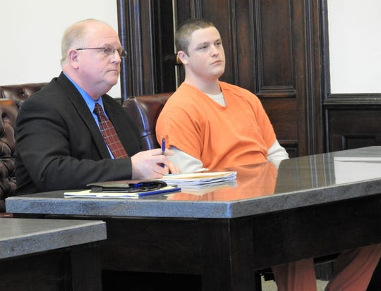 Public Defender Jeffrey Mullen with Garrett E. Emerson in Coshocton County Common Pleas Court. He received 40 months total in prison for charges of theft, breaking and entering and failure to comply with the order or signal of a police officer.
