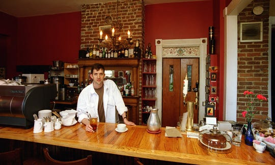 Walter Jahncke, one of the owners of Chat Noir Cafe in Sherman Hill, by the highly polished main bar of the restaurant.