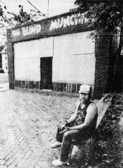 Michael O'Deay sits outside of a boarded up Blind Munchies after purchasing it before turning it into Mikey's Place in 1990.