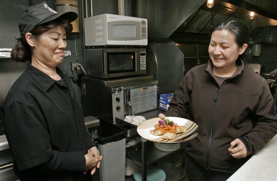 From 2007:  Su Nong, right, owner of Cafe Su, holds a plate of pot stickers that were made by her sister-in-law Siou Pheng Nong, a chef at the Valley Junction restaurant.