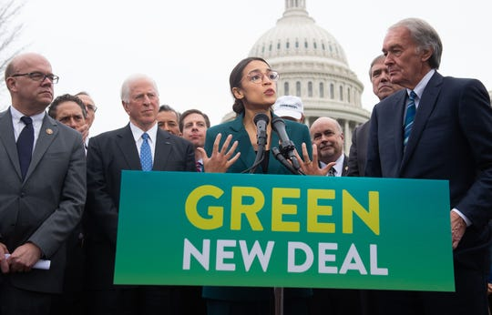 Representative Alexandria Ocasio-Cortez, Democrat of New York, and US Senator Ed Markey (R), Democrat of Massachusetts, speak during a press conference to announce Green New Deal legislation to promote clean energy programs outside the US Capitol in Washington, DC.. - US Senate Republican leaders forced a stunt vote March 26, 2019