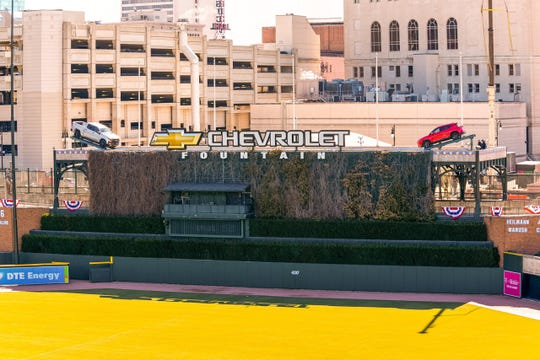 A silver 2019 Chevrolet Silverado 1500 LT Trail Boss and a red 2019 Chevrolet Blazer RS rest on their centerfield platforms in the Chevrolet Fountain at Comerica Park Tuesday, March 26, 2019.