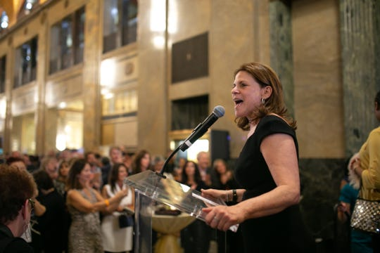 Amy Nederlander of L!FE Leaders spoke to the crowd gathered Thursday in the Fisher Building lobby.