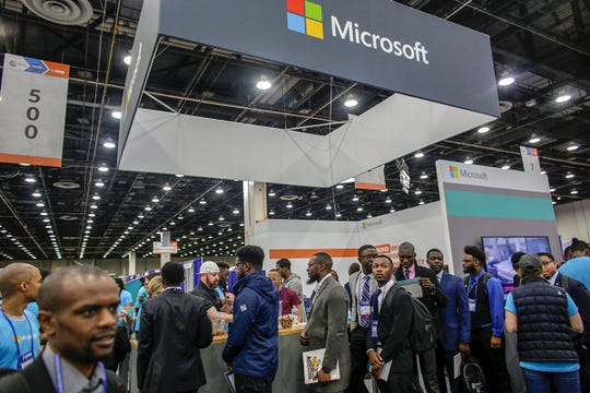 Conference Attendees line up to be interviewed at Microsoft, during the National Society of Black Engineers 45th annual conference at Cobo Hall in Detroit on Thursday, March 28, 2019.