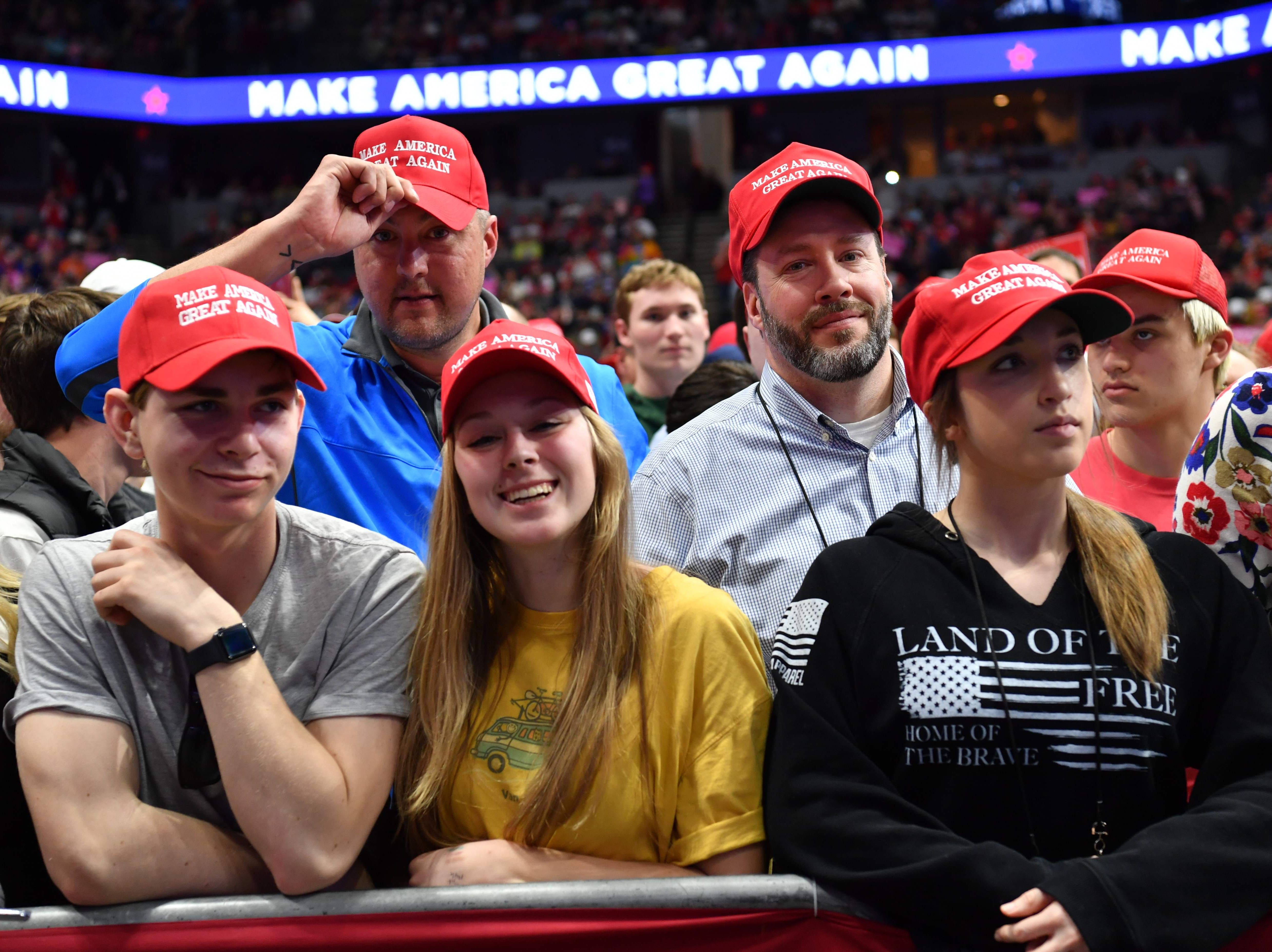Supporters of US President Donald Trump attend a campaign rally in Grand Rapids, Michigan on March 28, 2019.
