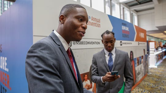 Jumel Jno Baptiste, 25, is a senior at Grambling University and is looking for a position with GE, Dell, or Denso at the job fair during the National Society of Black Engineers 45th annual conference at Cobo Hall in Detroit on Thursday, March 28, 2019. Standing in the background is Kish Jean, also of Grambling University.