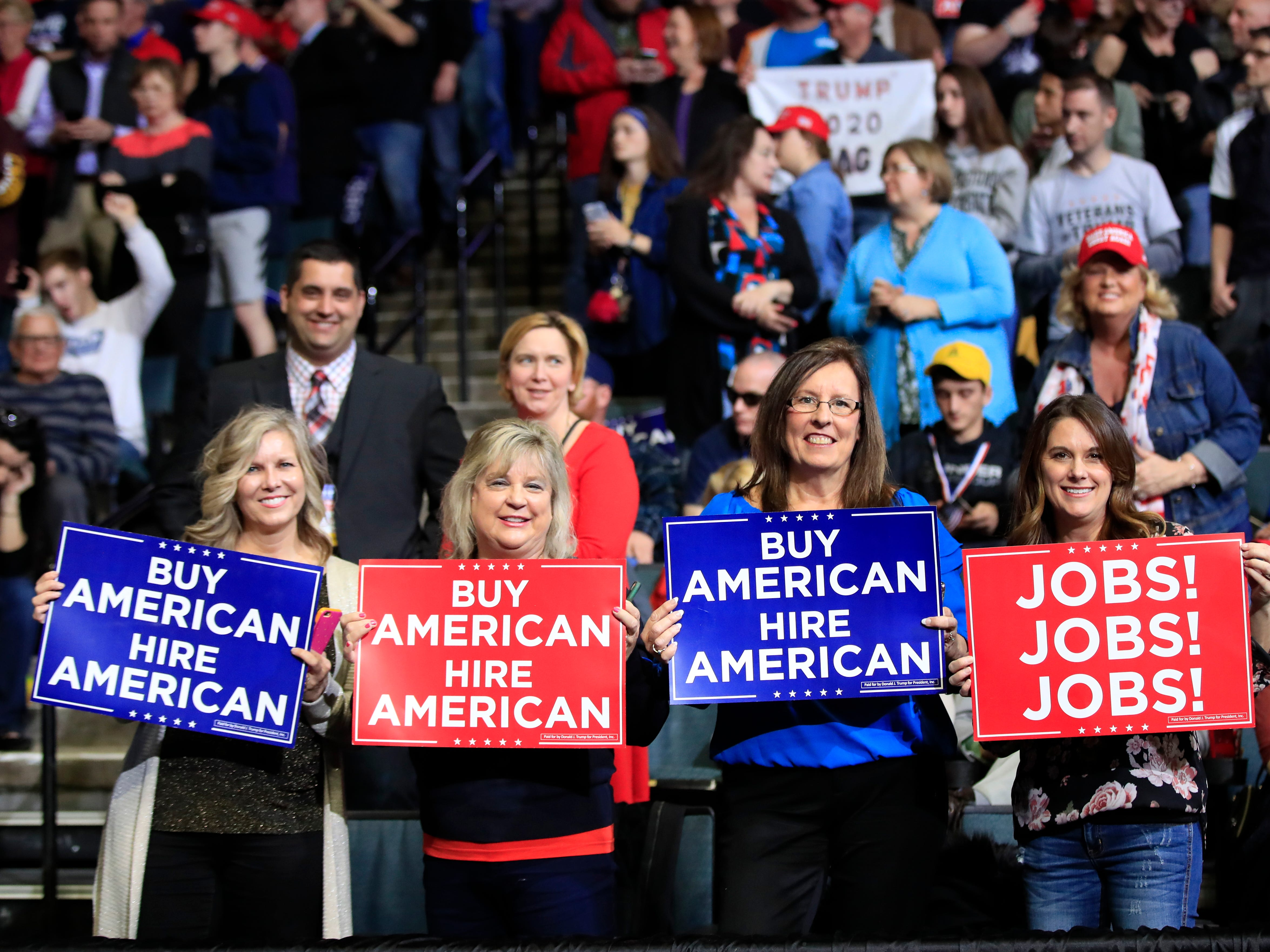 People wait for President Donald Trump to speak at a rally in Grand Rapids, Mich., Thursday, March 28, 2019.
