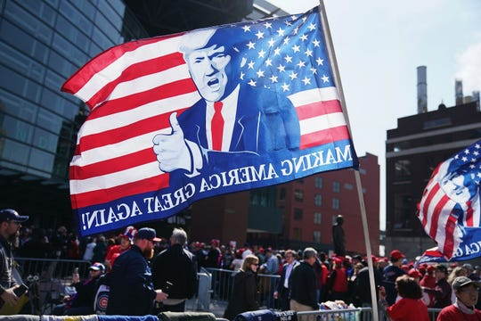 Supporters line up outside of the Van Andel Arena before the start of a rally with President Donald Trump on March 28, 2019 in Grand Rapids, Michigan. Grand Rapids was the final city Trump visited during his 2016 campaign.