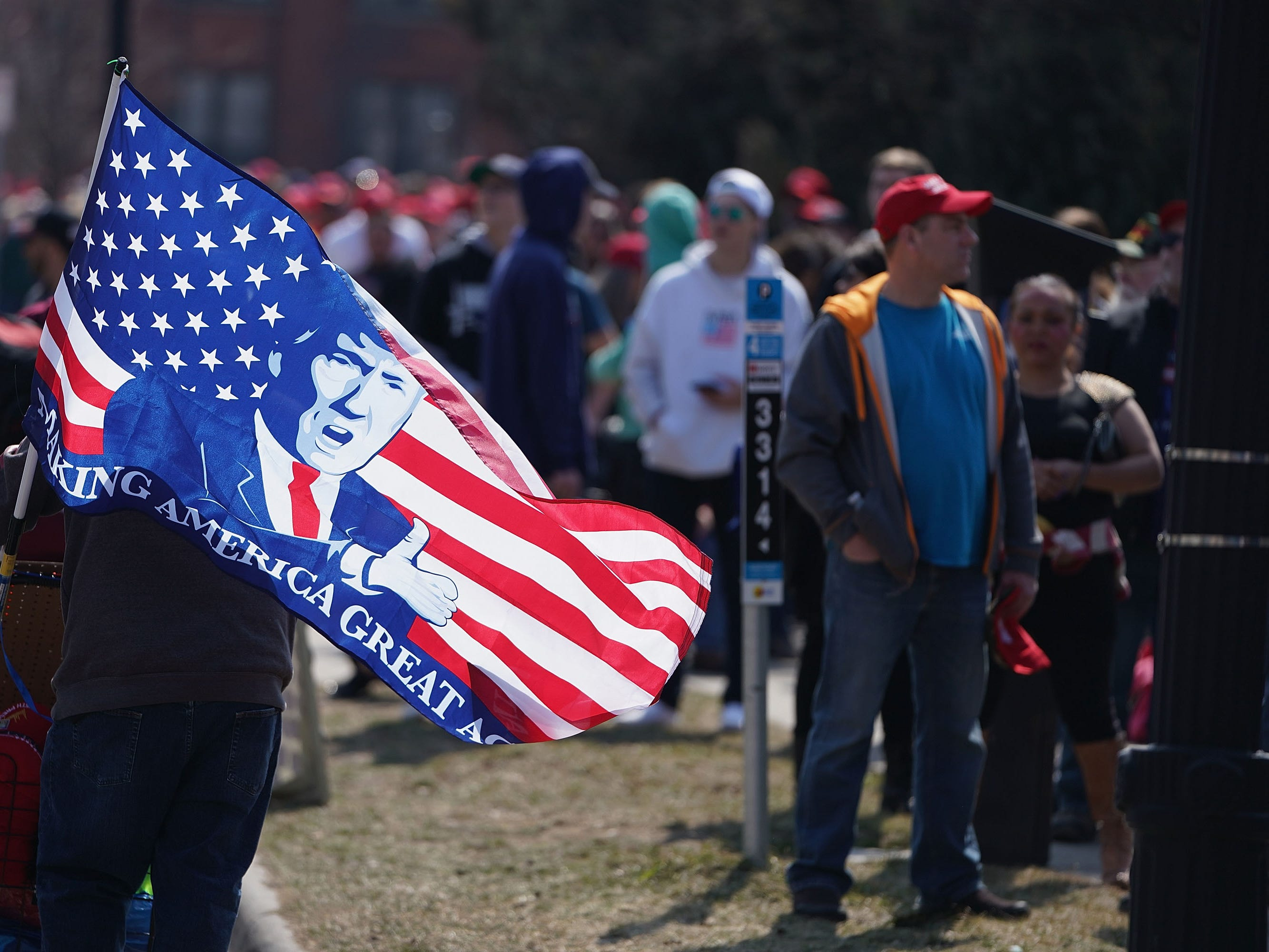 Supporters wait in line before the start of a rally with President Donald Trump at the Van Andel Arena on March 28, 2019 in Grand Rapids, Michigan. Grand Rapids was the final city Trump visited during his 2016 campaign.